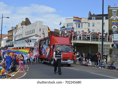 MARGATE, UK-AUGUST 12:  A float with costumed performers leads the colourful Gay Pride Parade, part of the annual Margate Pride festival. August 12, 2017
