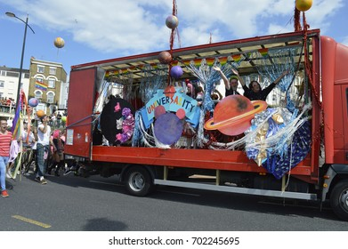 MARGATE, UK-AUGUST 12:  A float with costumed performers taking part in the colourful Gay Pride Parade, part of the annual Margate Pride festival. August 12, 2017 in Margate, UK.