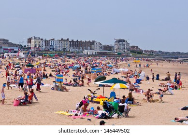 MARGATE, UK-JULY 14: Visitors flock to Margate's beach during the unusual heatwave in Britain.Margates Main sands have been awarded a blue flag for high standards. July 14, 2013 Margate, Kent UK