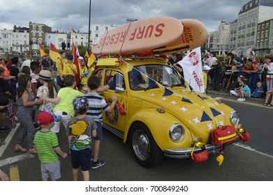 MARGATE,UK-August 6: Children greet the Thanet Lifeguards taking part in the annual Margate Carnival Parade, watched by crowds enjoying the occasion. August 6, 2017 Margate, Kent UK