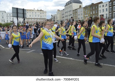 MARGATE,UK-August 6: Children take part in dance troupes during the annual Margate Carnival parade, watched by crowds lining the streets. August 6, 2017 Margate, Kent UK