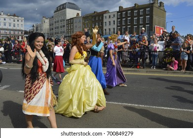 MARGATE,UK-August 6: Colourful costumed performers take part in the annual Margate Carnival watched by crowds lining the streets. August 6, 2017 Margate, Kent UK