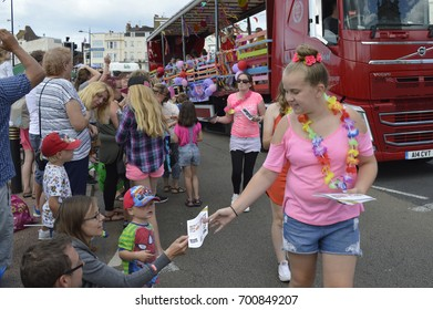 MARGATE,UK-August 6:  A colourful decorated float and costumed performers take part in the annual Margate Carnival parade, watched by crowds lining the street. August 6, 2017 Margate, Kent UK