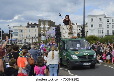 MARGATE,UK-August 6: One of the decorated floats with costumed performers takes part in the annual Margate Carnival Parade, watched by crowds enjoying the event. August 6, 2017 Margate, Kent UK