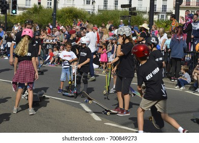 MARGATE,UK-August 6: A skateboarding group perform moves for the crowds as part of the annual Margate Carnival Parade, watched by crowds enjoying the event. August 6, 2017 Margate, Kent UK