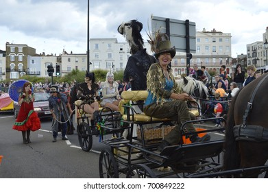 MARGATE,UK-August 6:Crowds watch members of the Sangar family take part in the annual Margate Carnival with the last horse-drawn stage show in England. August 6, 2017 Margate, Kent UK