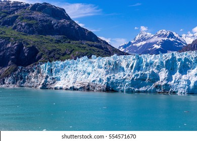 Margerie Glacier flows down out of the Alaskan Mountains into Glacier Bay.