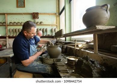 Marginea, Suceava / Romania - 04 26 2018 - Potter in his workshop