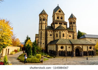 Maria Laach Abbey in Germany. Autumn landscape. The medieval church in autumn forest. Maria Laach Abbey is a Benedictine abbey. The medieval architecture of Germany.
