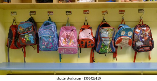 MARIA QC/CANADA DECEMBER 07 2016 Childrens rucksacks hung on their pegs in a daycare