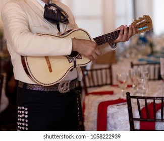 mariachi musicians with guitar at event