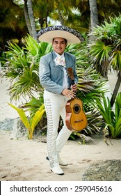 Mariachi singer playing a guitar in Mexico