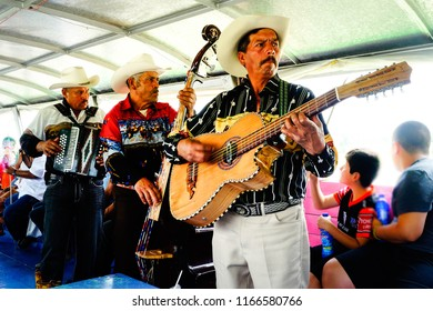 Mariachis musicians playing and singing. Mexico, June 2015.
