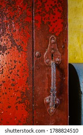 Mariager, Denmark July 30, 2020 Detail of an old colorful door and hand grip.
