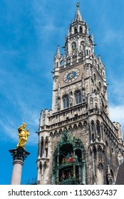 The Marian Column, Clock chimes and the tower of the New Town Hall in Munich, Germany