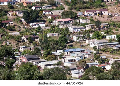 MARIANNHILL, DURBAN, SOUTH AFRICA - JULY 3, 2016: Many unknown people living in crowded low cost township housing  settlement in Mariann Hill