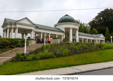 Marianske Lazne, Czech Republic - September 10, 2017: Outside view of the Caroline Spring Colonnade. There are people who can be seen in a distance