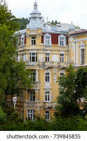 Marianske Lazne, Czechia - September 10, 2017: The beautiful tenement house is hidden among trees. This is how the coexistence of beautiful architecture and nature in this spa town looks like.