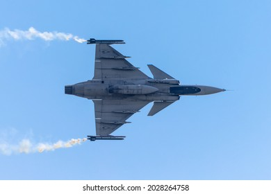 MARIBOR, SLOVENIA - August 15, 2021: Aeros - Saab JAS 39 Gripen from Hungary performing stunts at the airshow