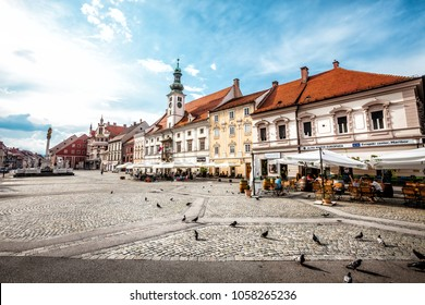 MARIBOR, SLOVENIA. August 16, 2015: Maribor, the main square. Slovenia. Wide angle picture of the central main square of the city of Maribor in Slovenia. Citizens and tourists sitting. Blue sky.