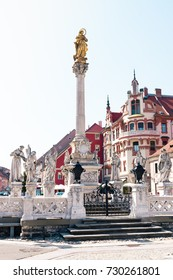 MARIBOR, SLOVENIA - AUGUST 24, 2017: Main square building and plague column at Main Square of the city of Maribor in Slovenia, Europe. Historical religious sculpture