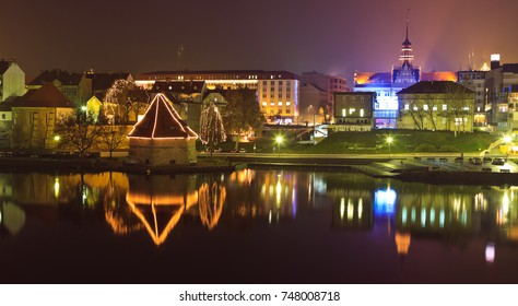 MARIBOR, SLOVENIA - DECEMBER 29th 2017: Illuminated decorated houses of Lent on the Drava river left bank
