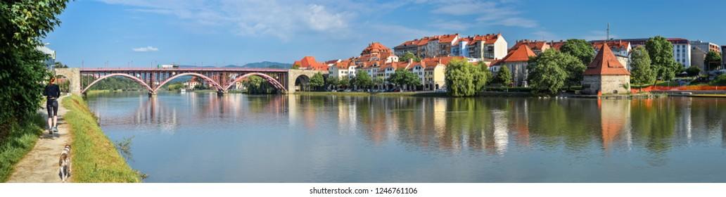 Maribor, Slovenia - May 20, 2018: Panorama of Maribor city, Slovenia. Drava River, old buildings and mountains of Maribor city center.