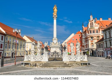 Maribor, Slovenia - May 22, 2018: Main square building and plague column in Maribor city, Slovenia, Europe. Historical religious sculpture and one of the best examples of baroque art in Slovenia