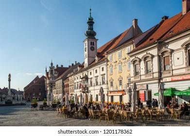 MARIBOR, SLOVENIA - OCT 16: People enjoy outdoor drinking in the main square of  Maribor, Slovenia on October 16, 2011.