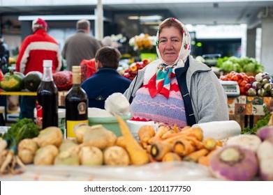 MARIBOR, SLOVENIA - OCT 16: a woman sells local vegetables at the local market in Maribor, Slovenia on October 16, 2011. Local shopping in Slovenia