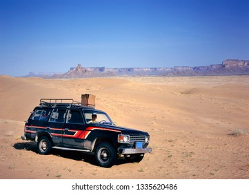 Marib,Yemen-September 18, 2013: Fourwheeldrive in the desert East from Marib in Yemen with woman driving.