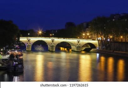 Marie Bridge, between Saint Louis Island and the Quai des Celestins. View from the river Seine at night, Paris, France.