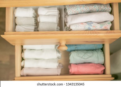 Marie Kondo tyding up method concept - folded clothes, copy space