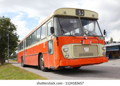 Mariefred, Sweden - August 7, 2016: Former SJ bus Volvo model B58 year 1970 with body made of Hagglund and sons painted in 1986 color scheme (orange and marked with SJ).