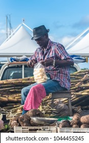 Marie-Galante island in Guadeloupe, the 13th january 2018, man who peels some sugar cane on the market
