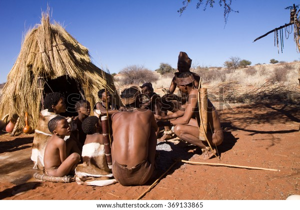 MARIENTAL, NAMIBIA - AUGUST 19: san bushmen family show people how they live in a village of the kalahari desert in Namibia august 19, 2013 in Mariental, Namibia