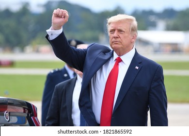MARIETTA, GA- SEPTEMBER 25, 2020: President Donald Trump gives a fist pump arriving at Dobbins Air Reserve Base. He will be speaking on Black Economic Empowerment at the Cobb Galleria Center.