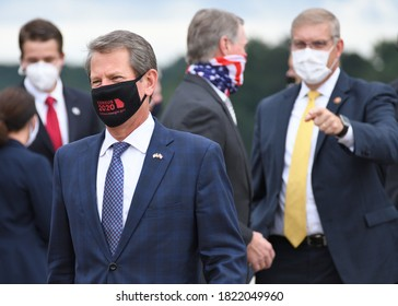 MARIETTA, GA- SEPTEMBER 25, 2020: Georgia Governor Brian Kemp speaks with the press as he awaits President Trump's Air Force One arrival at Dobbins Air Reserve Base wearing a census 2020 face mask.