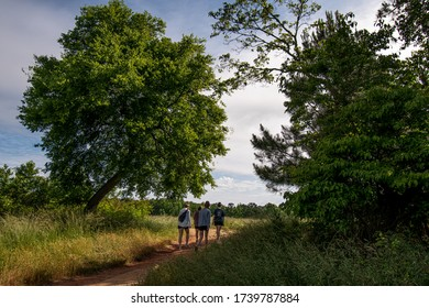 Marietta, GA / USA - May 23 2020:  After Pandemic Lockdown people getting out to enjoy a walk in the woods and the natural spring sunshine