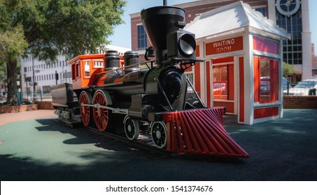 Marietta, GA / USA - Oct 4 2019:  Downtown Marietta, Georgia has a park in the square. The playground has a replica of a Civil War train.  Kids will climb on it and pretend they are the engineer.