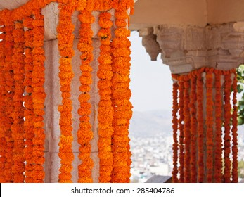 Marigold flower decorations hung at a Hindu celebration in Udaipur, Rajasthan