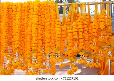 Marigold garlands stacked into large pieces