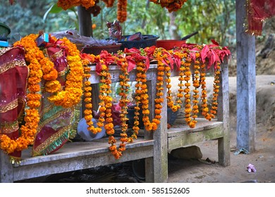 Marigold necklaces on the table for sale in Dakshinkali hindu temple in Pharping, Nepal