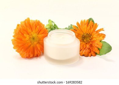 marigold salve with flowers and leaves