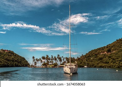 Marigot Bay, St. Lucia - October 21, 2019: Marigot Bay in St. Lucia. Boats moored in the harbor. Caribbean island with many palm trees and sailing boats.