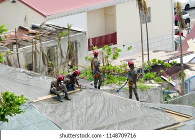 Marigot saint martin- November , 2017: Group of men fixing roof of homes after hurricane Irma.