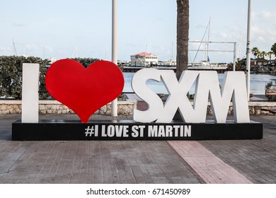 MARIGOT-AUGUST !: Sign and statue I love St Martin in Marigot, seen in Marigot , St.Marten on August 1, 2015