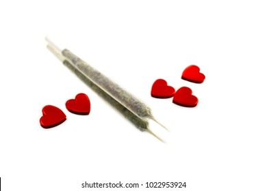 Marihuana with hearts stock images. Marijuana joint on a white background. Romantic marijuana stock images. Valentines Day concept
