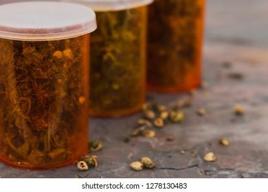 Marijuana bottled on a stone table