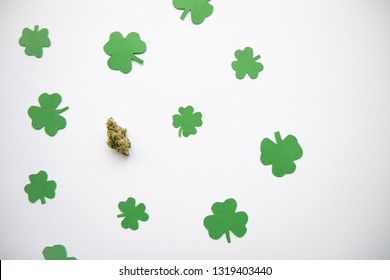 Marijuana Bud against Four and Three Leaf Clovers St Patricks St Pattys Day - Top Down, Left Aligned View